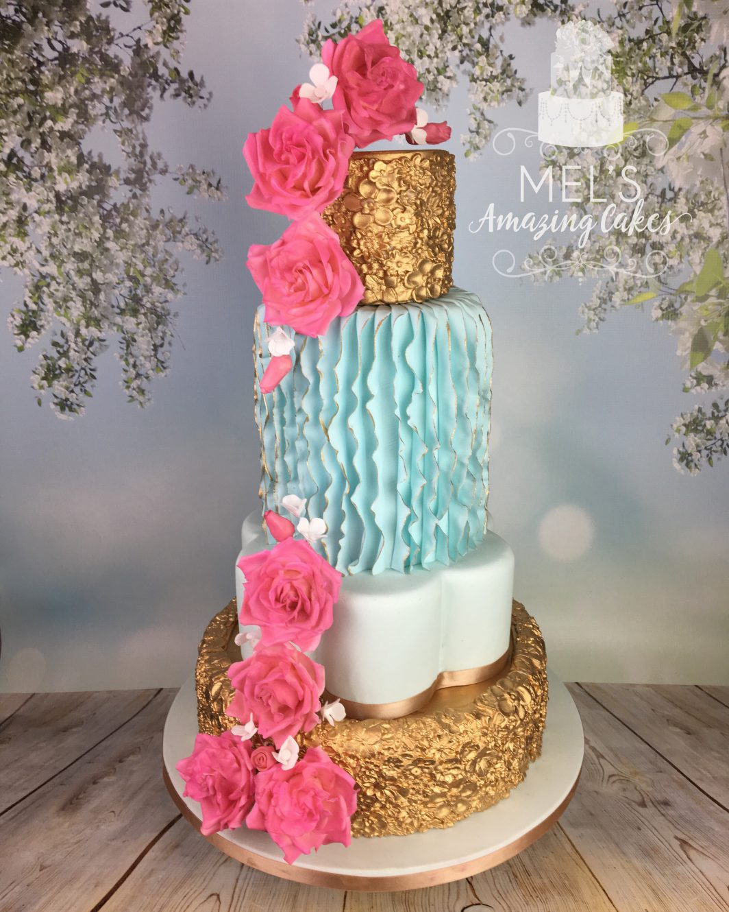 gold blue and pink wedding cake