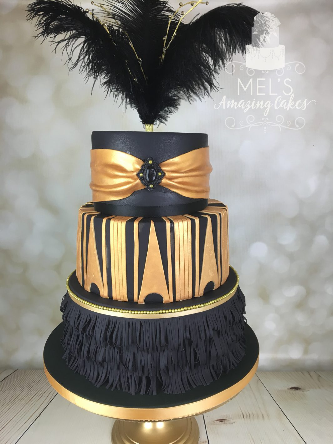 Black fringing with gold details wedding cake
