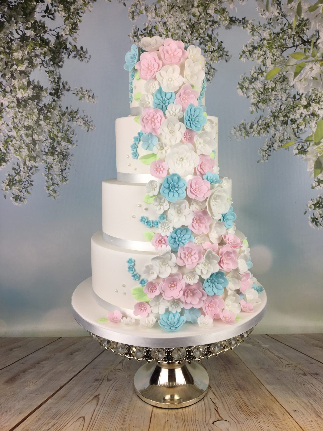 cascading blossoms wedding cake