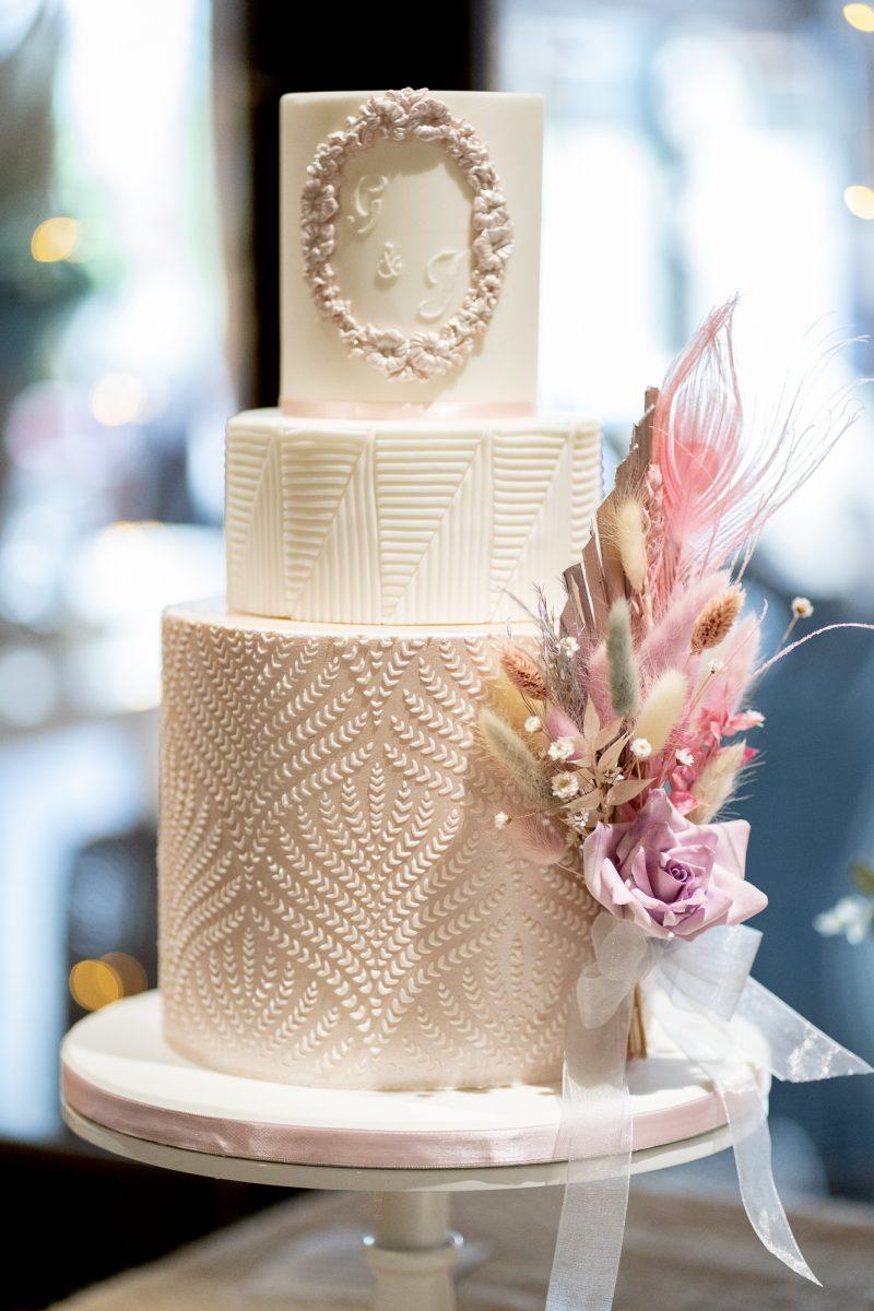 Modern wedding cake with dried flowers send foliage